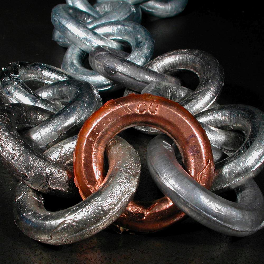 Link in multi-metal chain, a sample of the element Copper ...