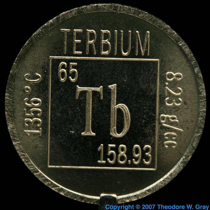 Element coin, a sample of the element Terbium in the ...