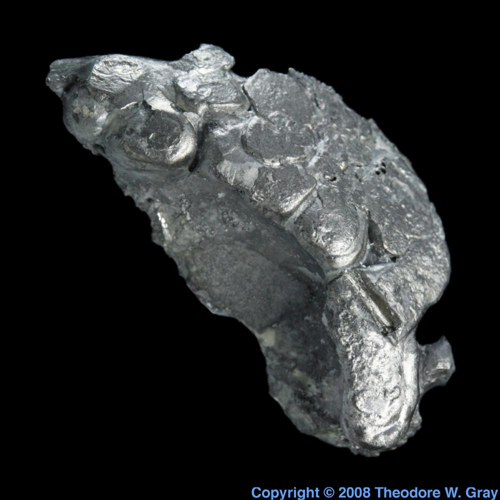 Odd shaped lump a sample of the element thulium in the periodic table thulium odd shaped lump gamestrikefo Gallery