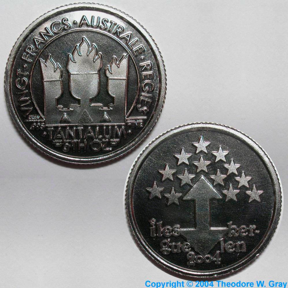 Fantasy coin, a sample of the element Tantalum in the