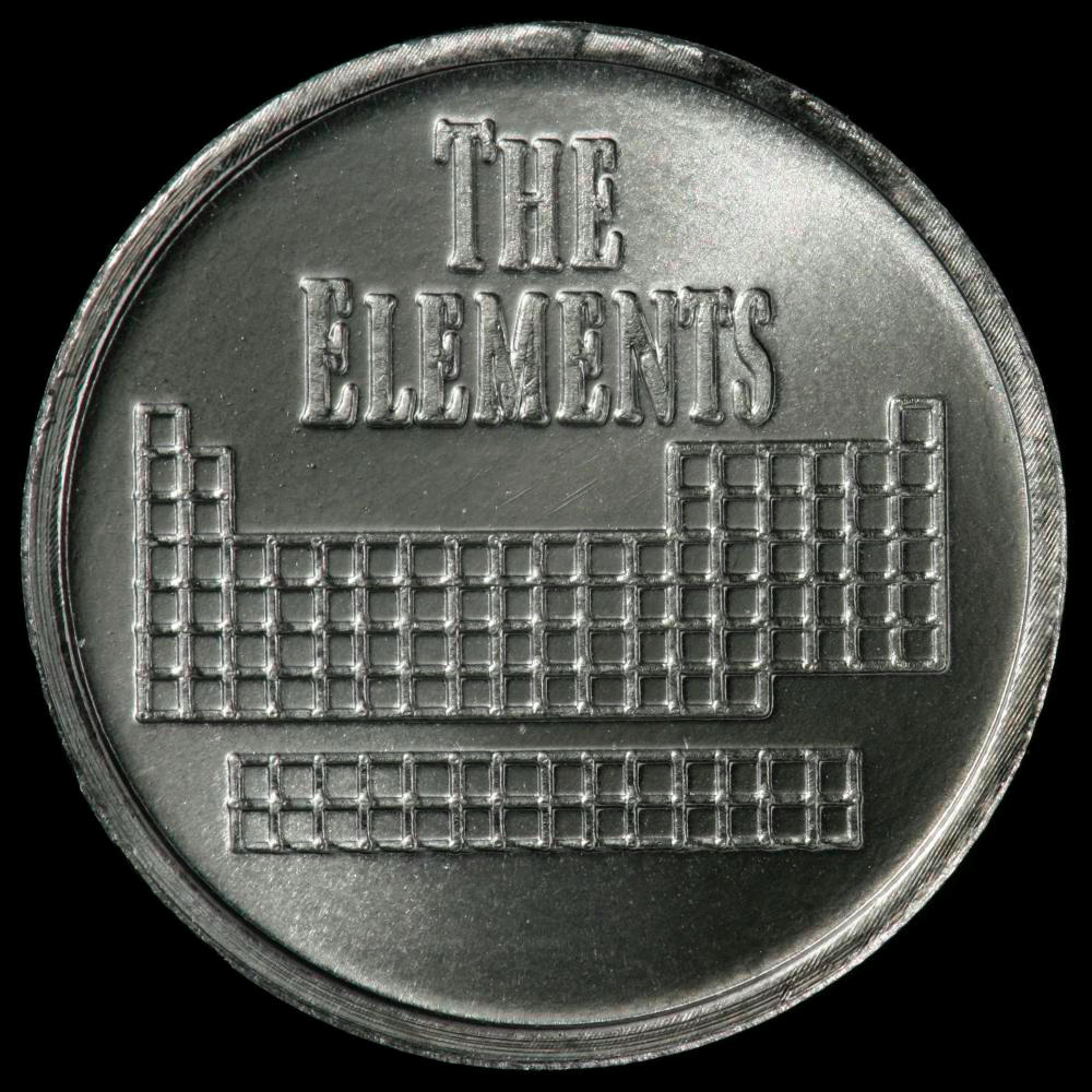 Element coin, a sample of the element Tantalum in the ...