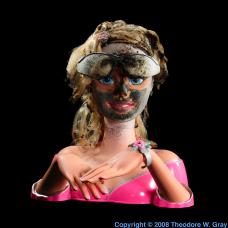Hydrogen Burned Barbie doll with glasses